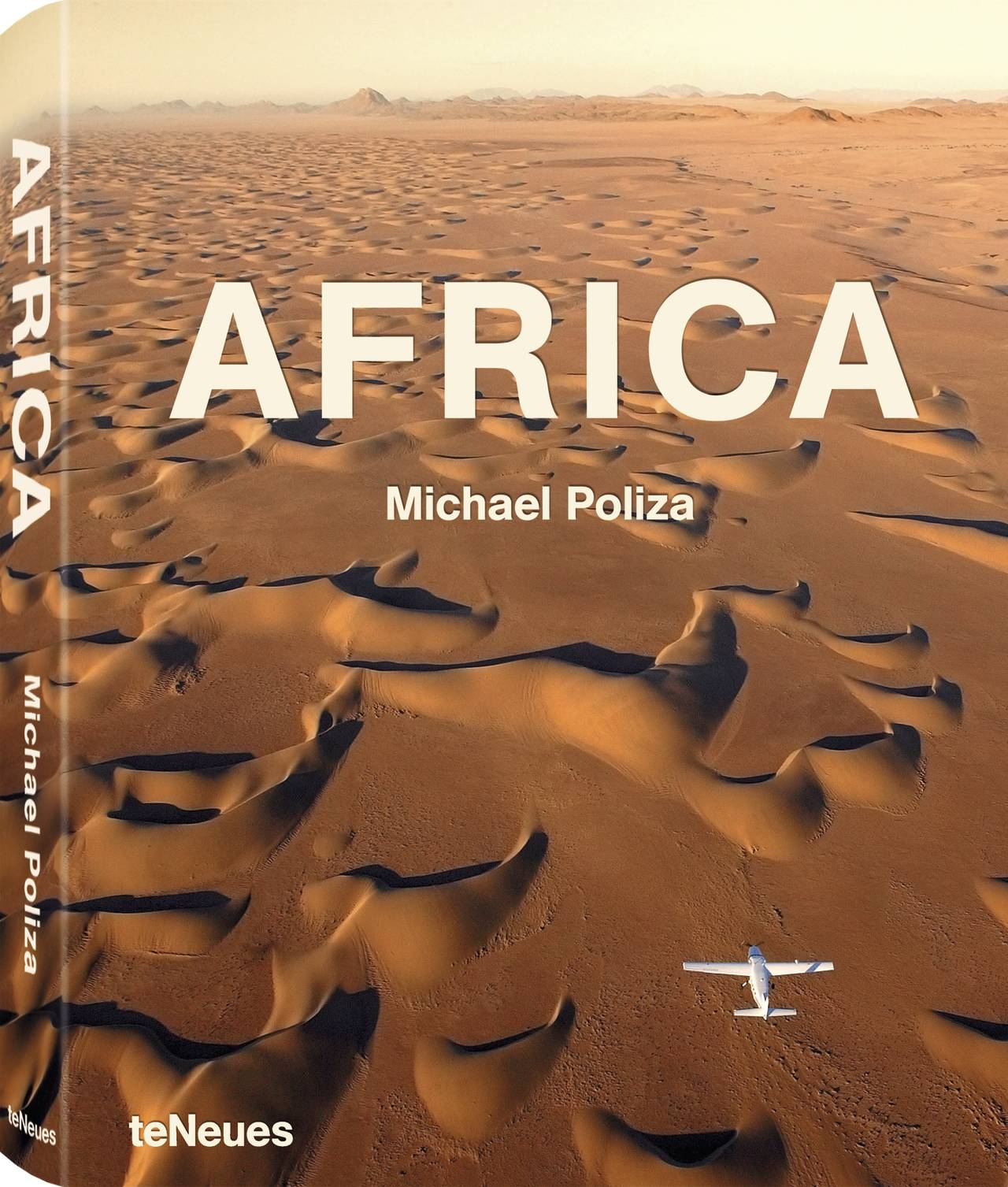 © AFRICA by Michael Poliza - published by teNeues, www.teneues.com. Flight to nowhere, Barchan Dunes, Skeleton Coast, Namibia, Photo © Michael Poliza. All rights reserved. www.michaelpoliza.com